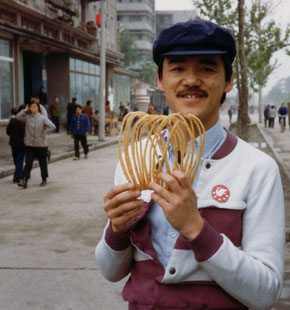 Me with street food. Yichang in Hubei province, near the Three Gorges.