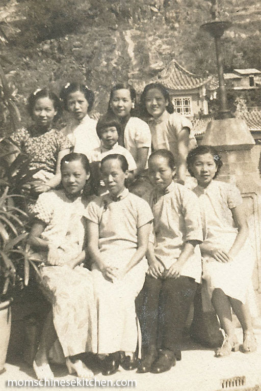 This photo of my mother's family was taken in Guangdong province in the late 1930s. My mother is seated and is the first person on the left. Number Five, wearing dark trousers, is third person from the left.